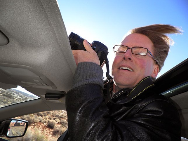 Overwhelmed by the beauty of Arches National Park, Robert shoots through my open sunroof.