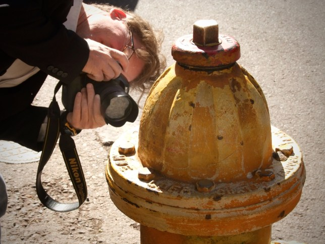 Robert photographs a fire hydrant in Santa Fe.