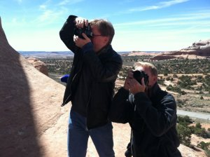 Robert's sister Deb made this image of Robert and me photographing Wilson Arch.