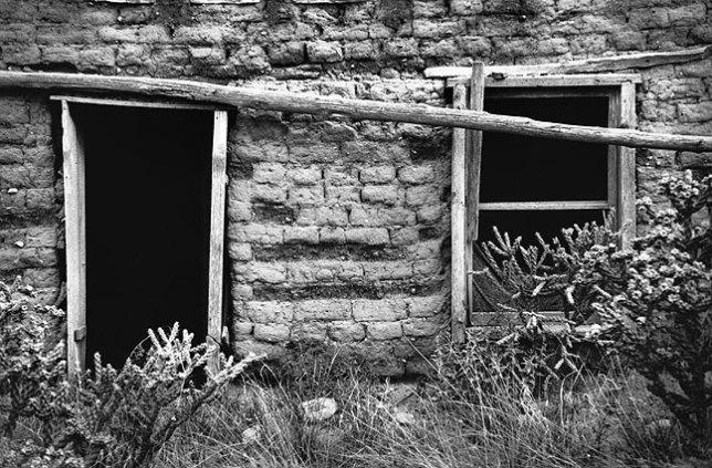 Door and window, abandoned adobe building, Villanueva, New Mexico