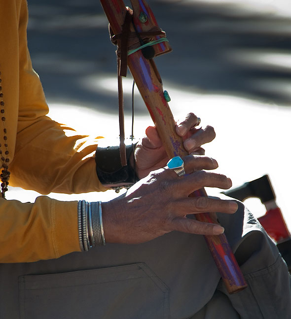 Abby made this image of a flute player's hands. I made images of this same musician in April.
