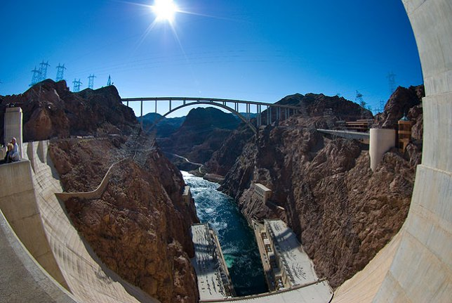 This is a fisheye view from the top of Hoover Dam looking south down the Colorado River, showing the newly-completed Mike O'Callaghan - Pat Tillman Memorial Bridge.