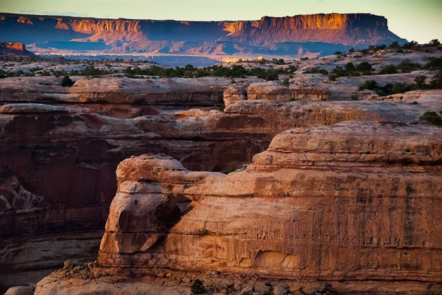Light shines in and out of the canyons of The Maze at last light.