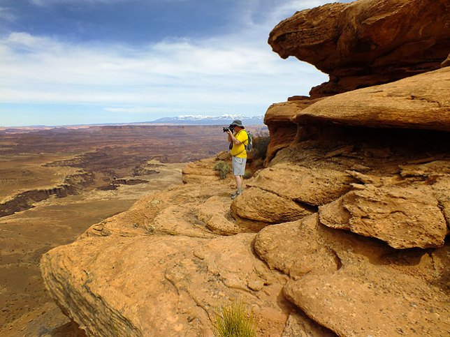 Jim looks over Gooseberry Canyon on his way to the White Rim Overlook at Canyonlands.