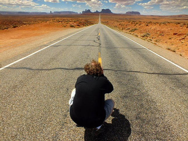A classic American road photo: Jim photographs Monument Valley from U.S. highway 163. Movie fans might recall that this is the spot where Forrest Gump decided he was finished running across the United States.