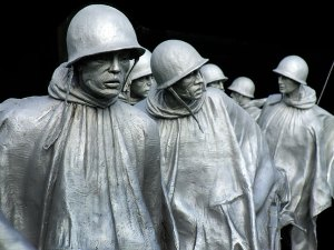 Soldiers depicted at the Korean War Memorial are larger-than-life stainless steel statues showing a squad on patrol.