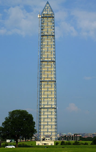 The Washington Monument wears a scaffolding for earthquake repairs.