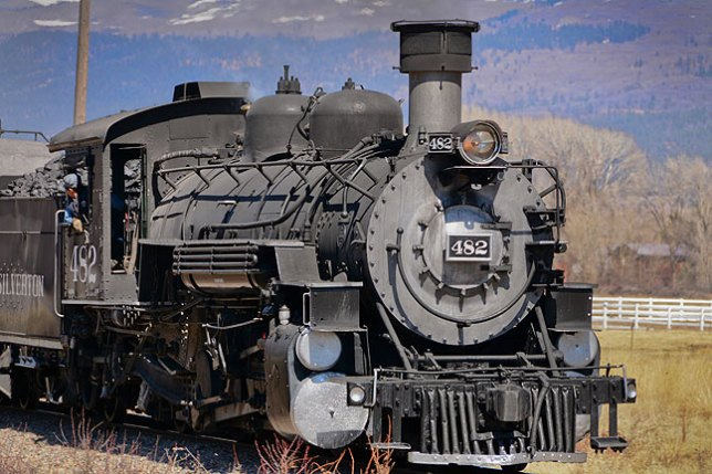 North of Durango, I spotted this train, the Durango and Silverton Narrow Gauge Railway, chugging south. After I photographed it, it roared past, and the smell from the coal-burning steam engine was quite foul.
