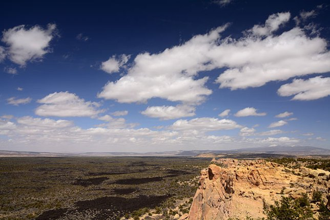 Windblown clouds fill a perfect sky at El Malpais National Monument.