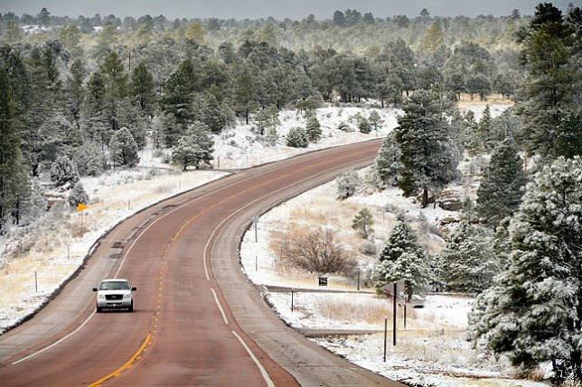 During the night I spent in Gallup, New Mexico, it snowed lightly. I photographed this delicate scene on New Mexico 602 near Vanderwagen.