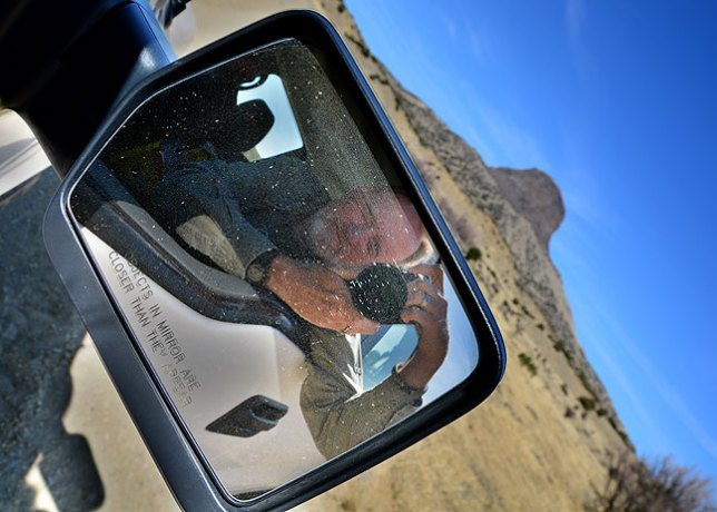 I made this outside-the-box (for me) self portrait in Greg's side mirror near Cabezon Peak.