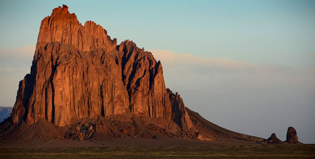 Shiprock Peak, visible for many miles in the Four Corners region, shines at first light.