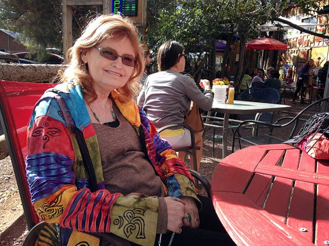 "Abby smiles at an outdoor café, The Hollar, in Madrid, New Mexico. ""I could live here,"" she said."