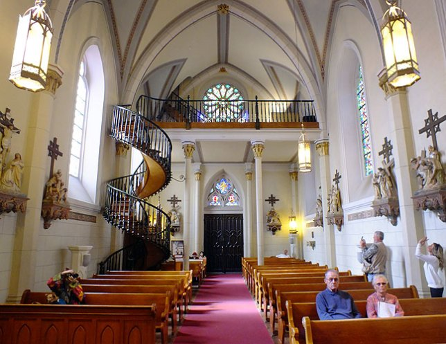 "One of our checklist items for the Santa Fe Plaza was Loretto Chapel, home of the spectacularly engineered (though not ""miraculous"" as it is claimed) spiral staircase, seen on the left side of the frame."