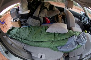 This fisheye view shows my sleeping bag stretched out on the fold-down seats of my Nissan Rogue as I prepare to sleep.