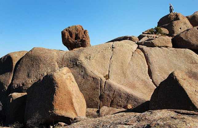 The author stands on a peak nicknamed Sitting Rock in the Charon's Garden area of the Wichita Mountains Wildlife Refuge.