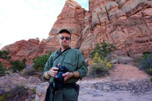 Your host makes pictures as our Canyonlands hike progresses.