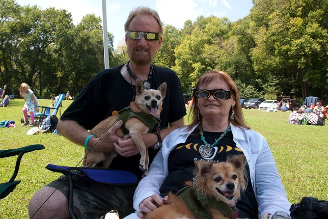 Abby and I pose with our eclipse glasses on and the Chihuahuas in our laps. We make up half of Team Blackout, and the dogs are our mascots.