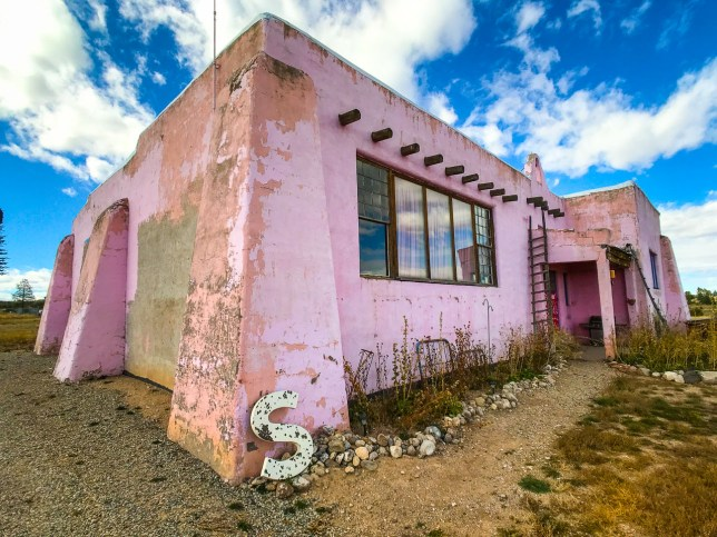 The Old Pink Schoolhouse in Tres Piedras, New Mexico is still old and pink, but on this visit, it appeared to be unoccupied.