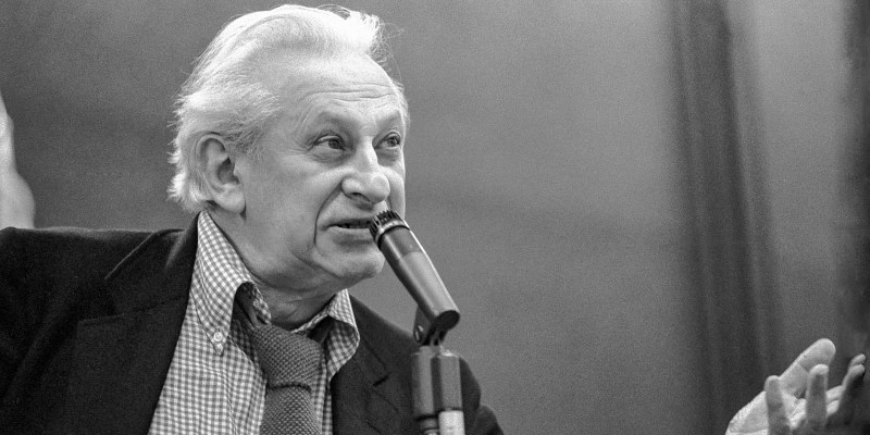 Studs Terkel speaking and gesturing