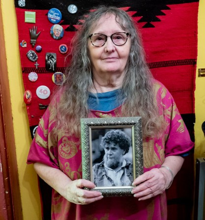 Linda holding aa photograph of her brother