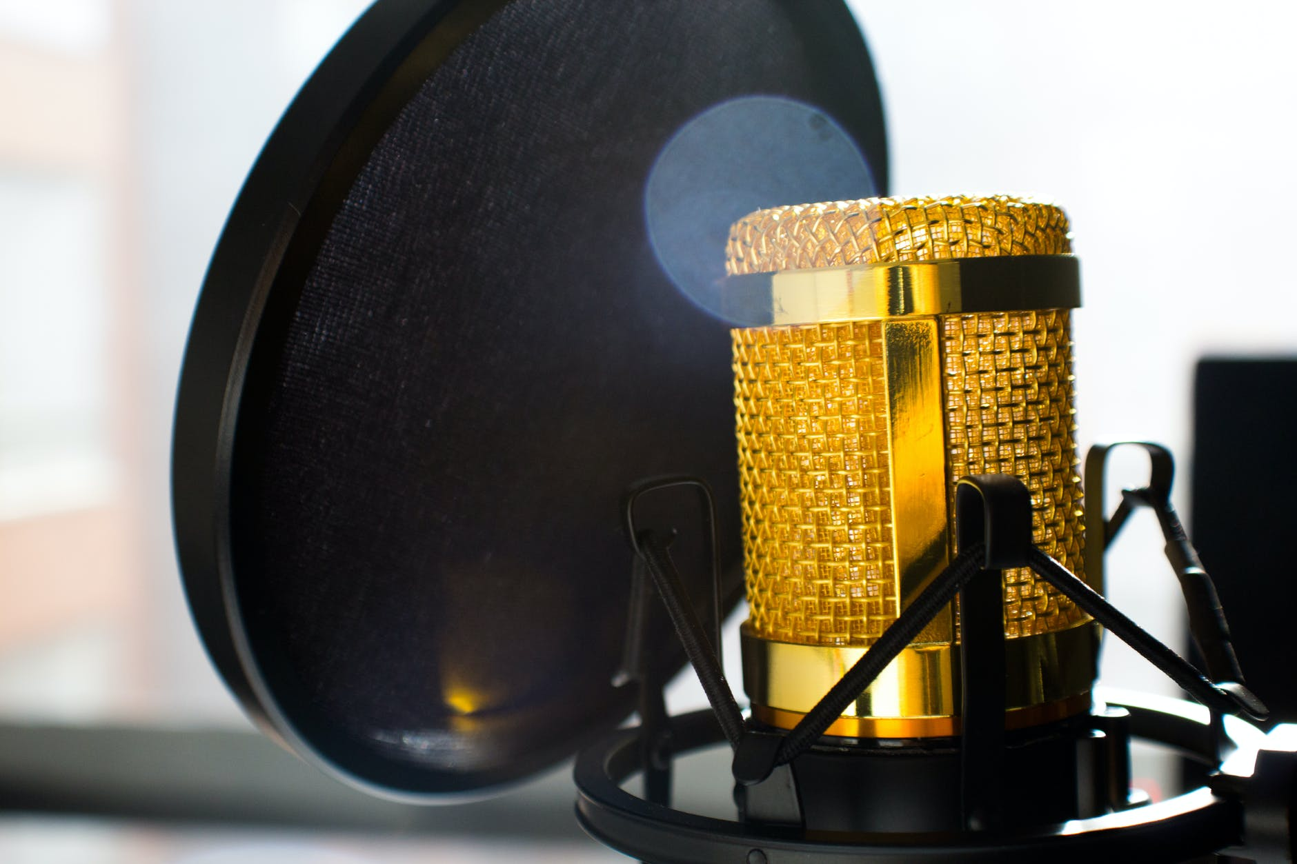 close up photo of gold colored and black condenser microphone