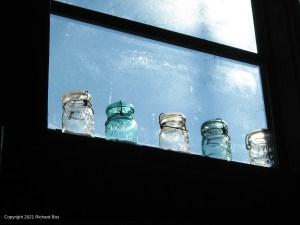Bottles in sunny window.