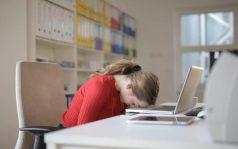 Writer resting head on keyboard