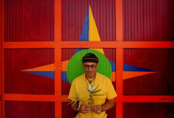 Harry Segil takes a moment in front of a garage door at his 3500 sq. ft. house in Wilshire Vista in L.A. Segil, of Harry ARt Furniture, has just sold the house and is moving to a very pared down work/loft space in Culver City. He is selling everything in the house in the next 3 weeks.