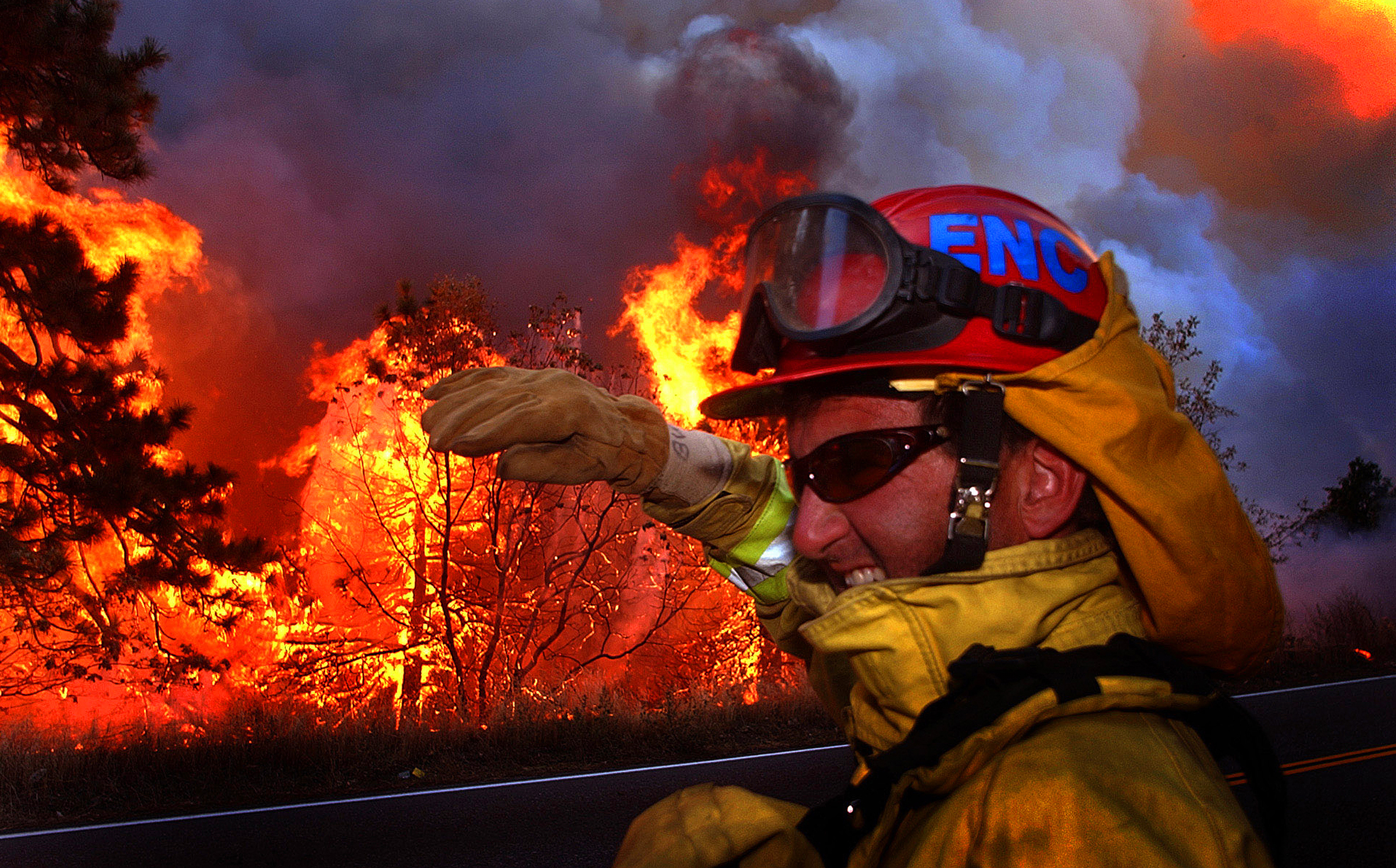 A firefighter turns away from the heat from the oncoming firestorm approaching Highway18, near Lake Arrowhead, Ca. 1dogge02.jpg Feeling the Heat