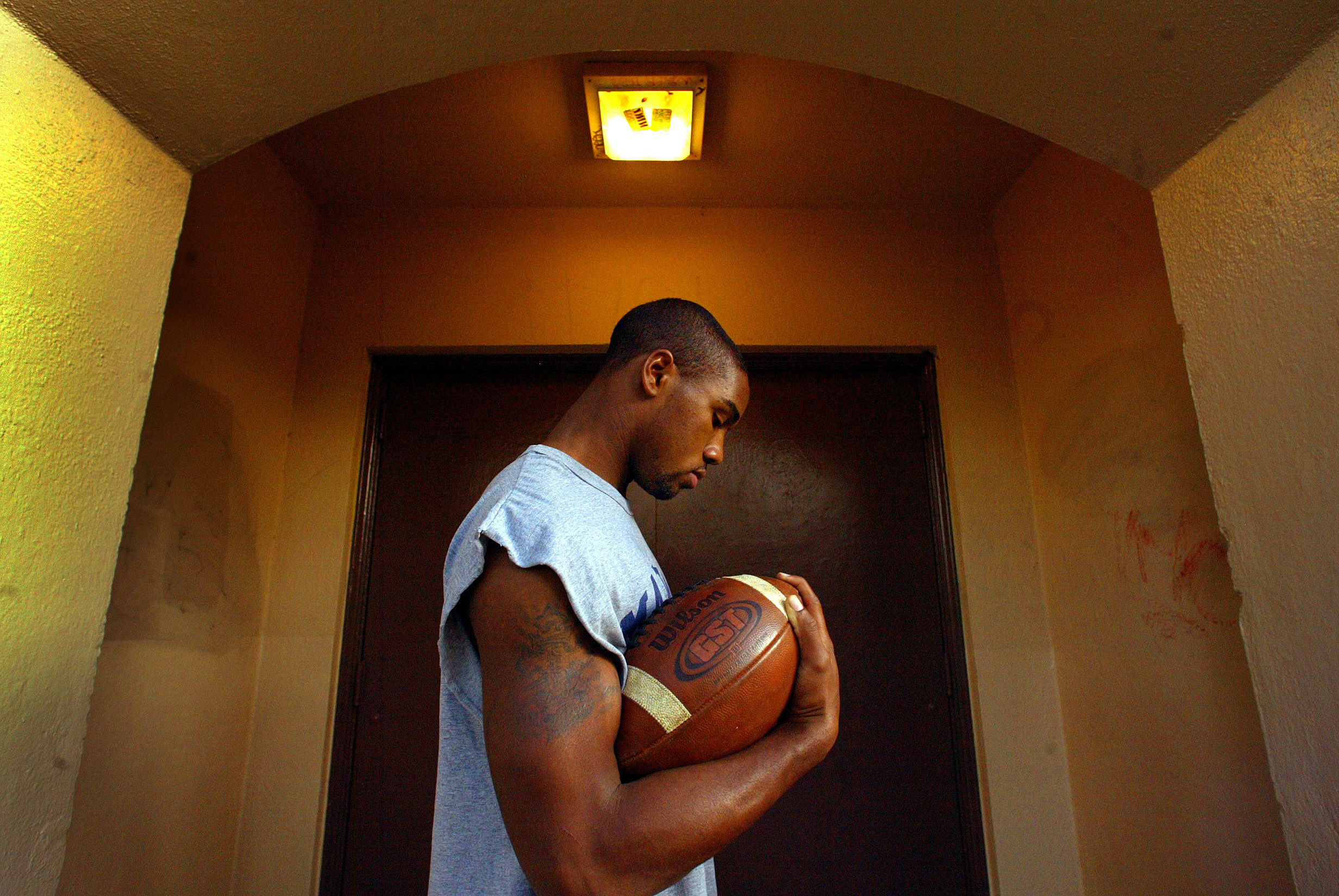 Marshall High football player James Wilson on campus in L.A. He was once homeless, living out of a car and he now lives in a group home. Ê