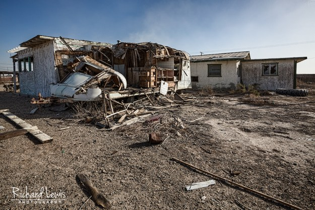 Old Trailer In A Sand Storm at Bombay Beach by Richard Lewis