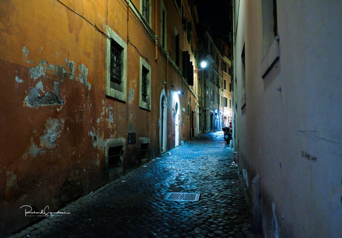 image showing interesting colours of the walls in the side streets of rome (februay images