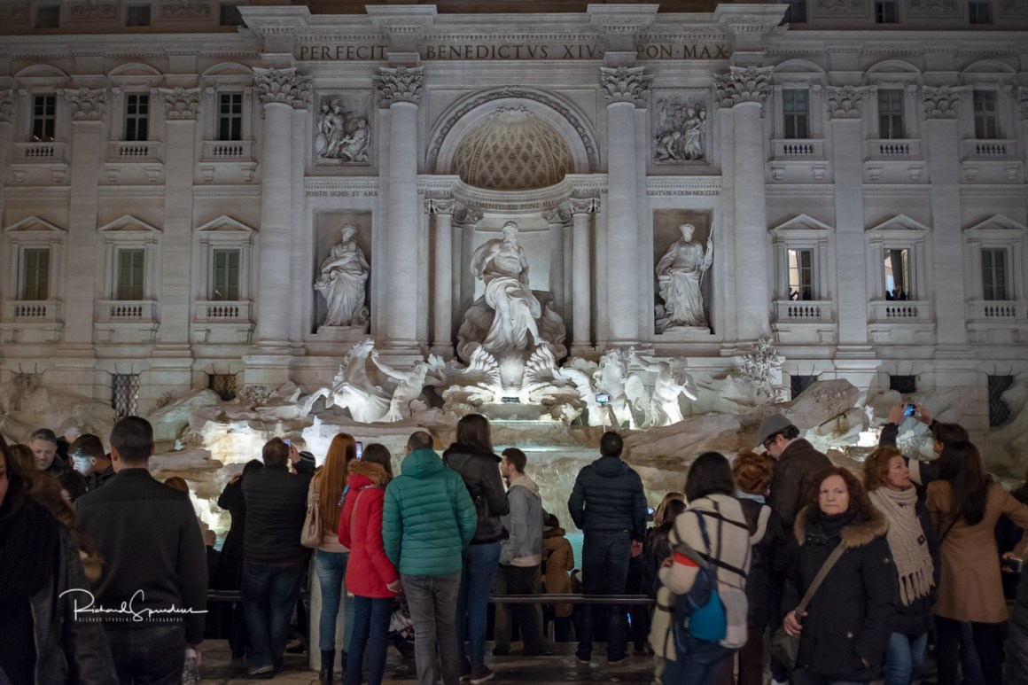 image from the trevi fountain square shoot around 20:00 still lots of tourists stood in front of the fountain (february images)