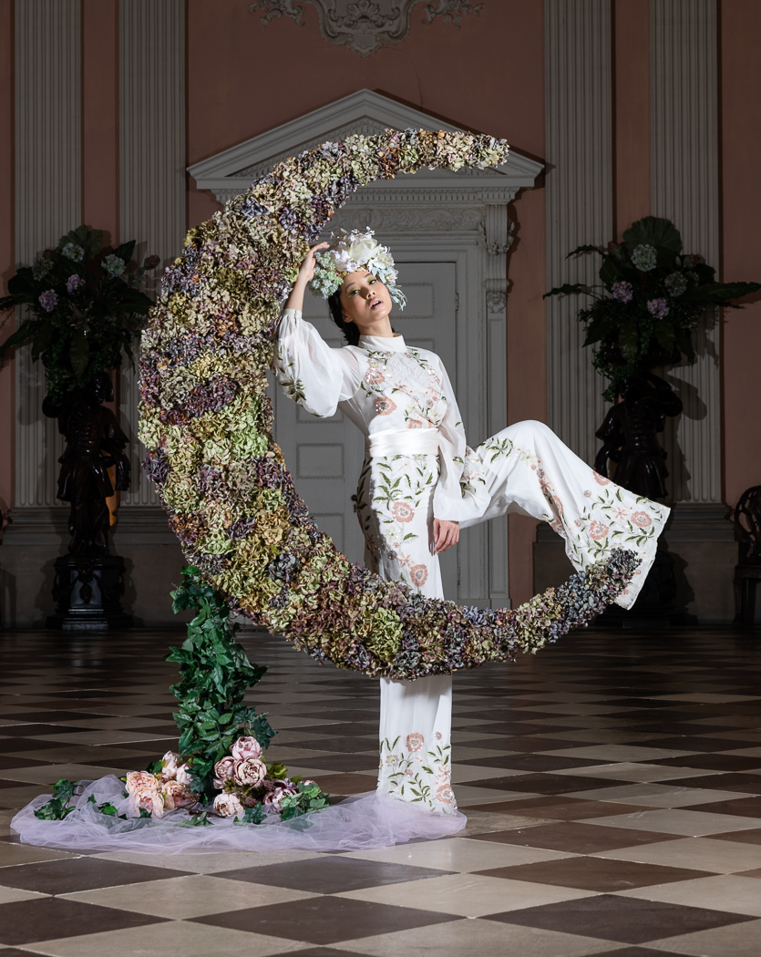 Image showing model Jaye Hicks jumping the floral moon
