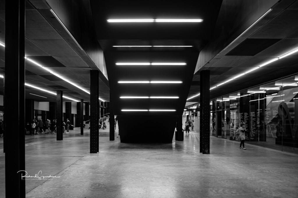 the image shot in b/w show the strong lines and lighting and pillars give