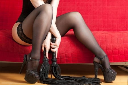 woman with two floggers