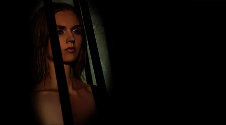 Avril Gillios behind bars
