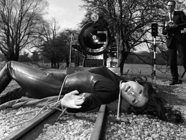 Mrs. Peel tied on railroad tracks