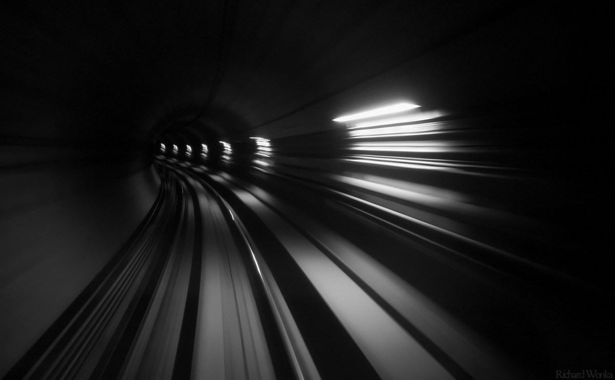 A view into a subway tunnel from the front of a train.