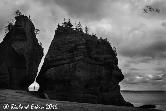 Took  this in 2009 at Hopewell in Canada near the Bay of Fundy.  Didn't realize at the time that I had a photographer between the rocks.  It is good to go back and review old work every now and then, especially as your post-processing skills in improve.