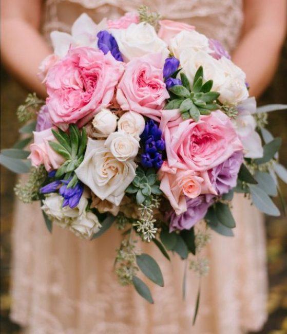 Pink, purple, white wedding bouquet