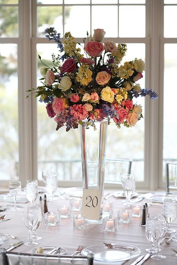Pastel centerpiece on tall glass vase