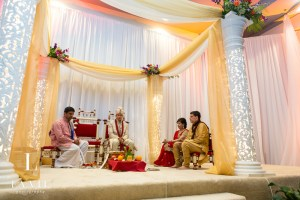 Mandap drape and bright flowers