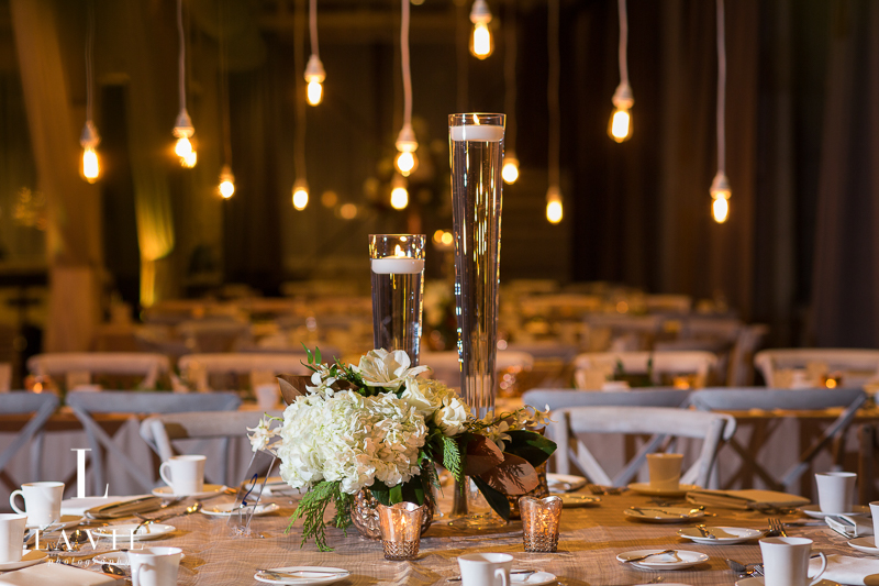 white centerpiece and floating candles