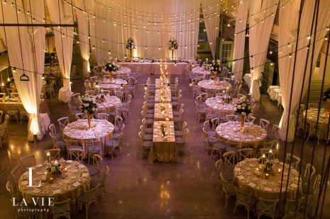 Cafe lights over wedding reception decor