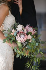 wedding bouquet with greenery and protea