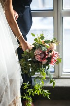 wedding bouquet with protea and greenery