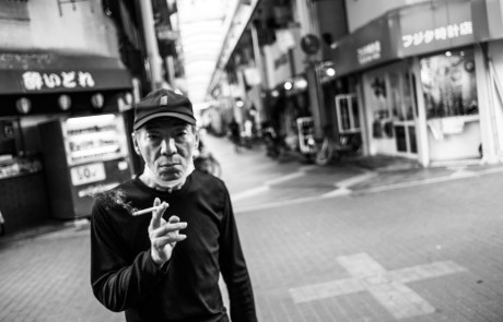 A man smoking pointing me