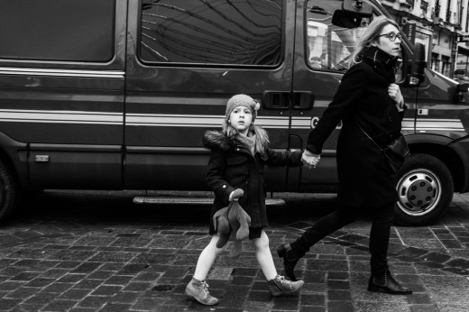 Mother and daughter in front of a riot van